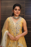 Nivetha Thamos in bright yellow dress at Ninnu Kori pre release function ~  Exclusive (71).JPG
