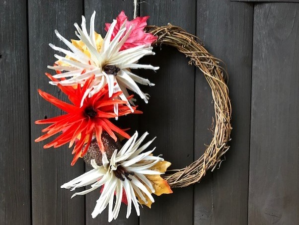 Completed wreath hanging on a door by a piece of string