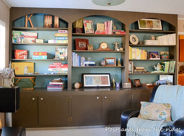 Painted bookcases with paintable wallpaper on the back walls. Postcards from the Ridge