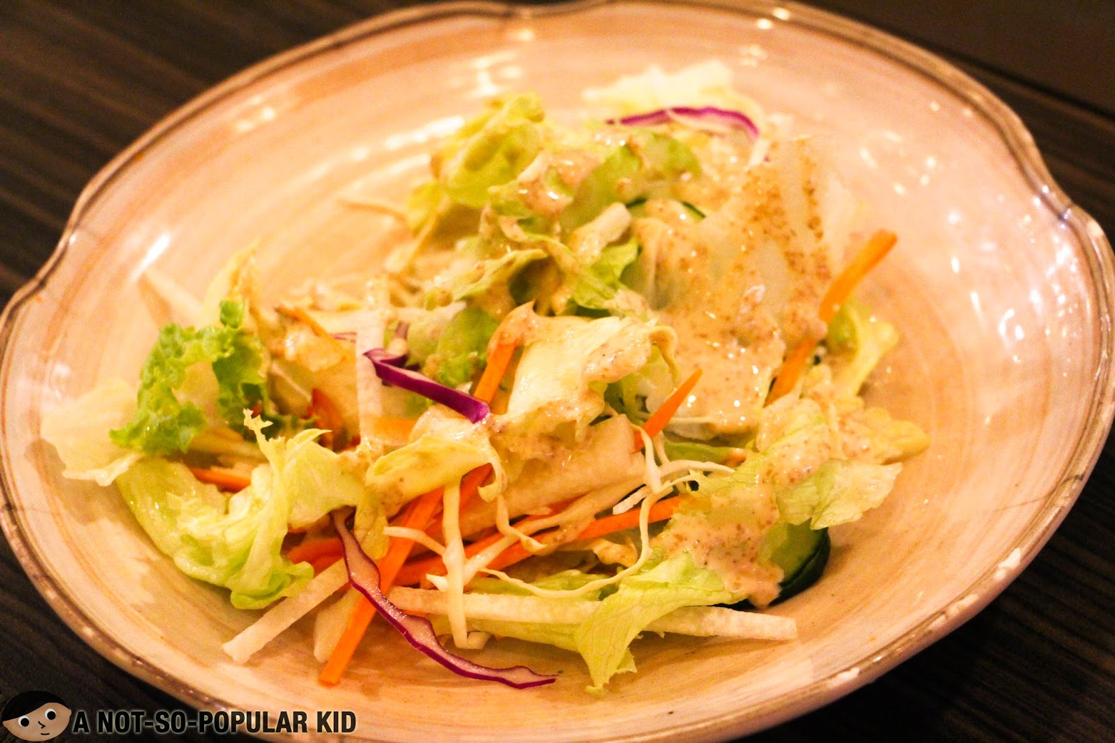 Fresh salad sides with sesame dressing of Genji-M