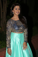 Nikki Galrani in Green Skirt  Top at Marakathamani music launch ~  Exclusive (50).JPG