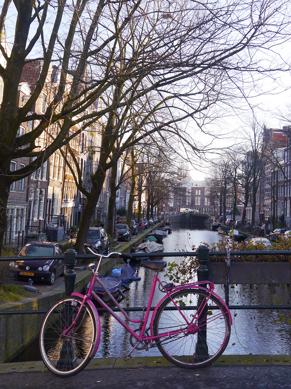 Colourful pink bicycle on an Amsterdam street