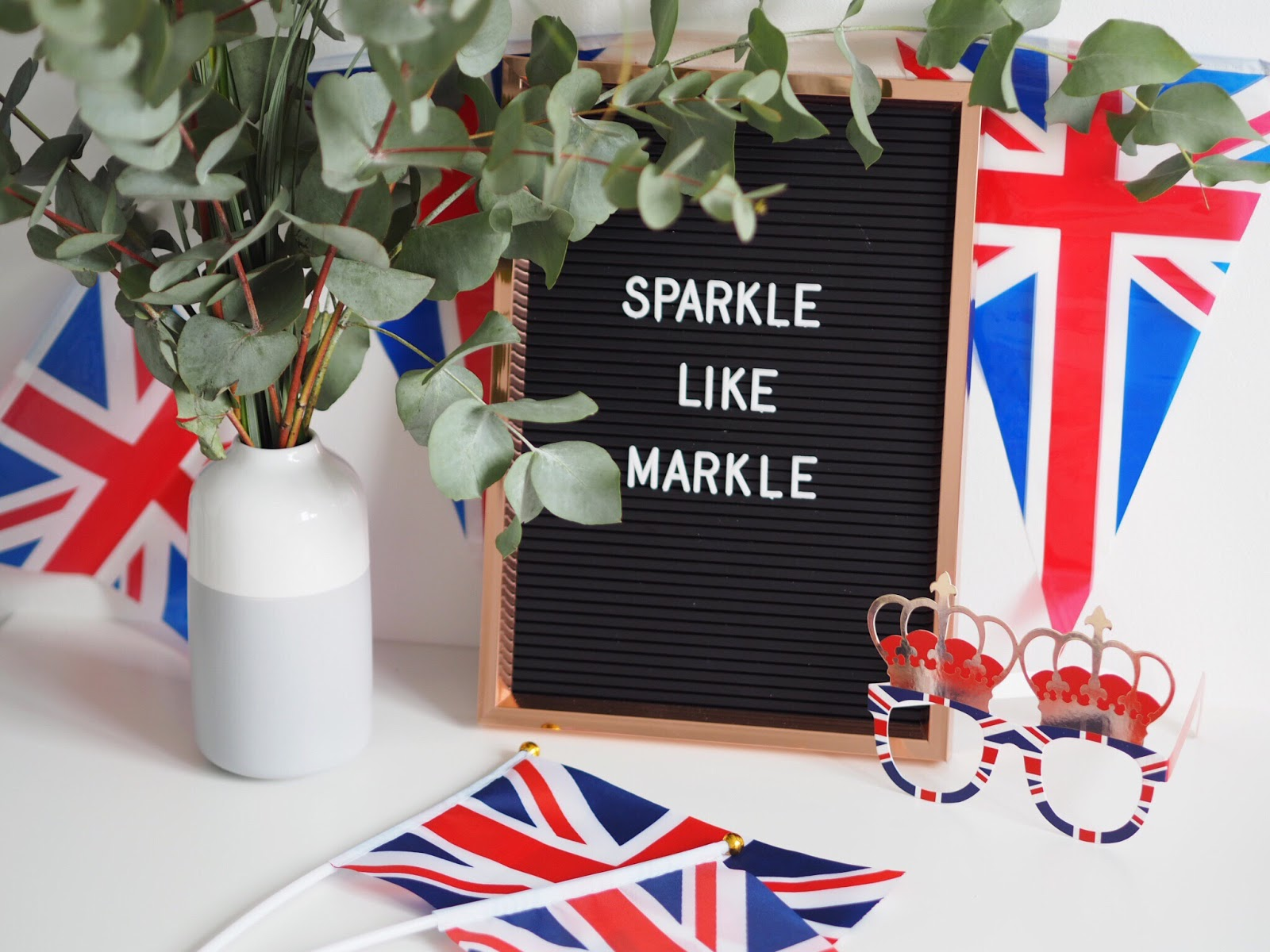 Primark peg board with union jack bunting, flags and glasses flat lay with eucalyptus
