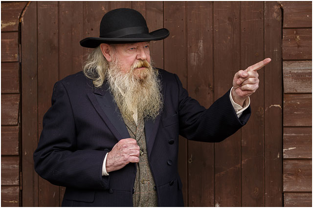 portrait-of-wild-west-preacher-dressed-in-black-and-pointing.jpg d92dc910141