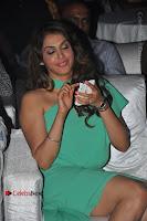 Actress Isha Koppikar Pos in Green Dress at Keshava Telugu Movie Audio Launch .COM 0015.jpg