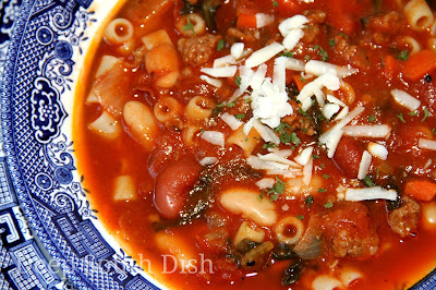 The popular American version of Pasta e Fagioli soup, made with a mirepoix of chopped onion, carrots and celery, ground beef, tomatoes, greens, white and red kidney beans and ditalini pasta.