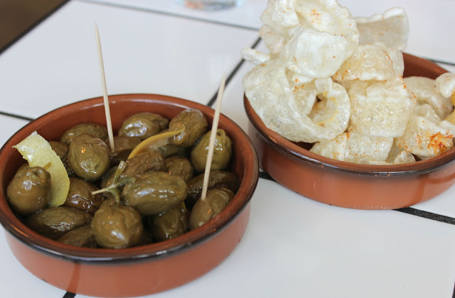 A picture of OAKS Restaurant Nottingham Pork Crackling and Baked Olives, Garlic & Rosemary