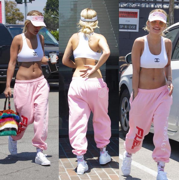 Rita Ora bares belly as she steps out in baggy trousers