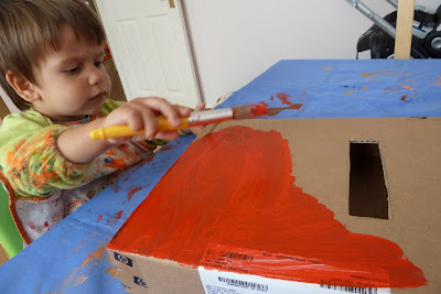 Child painting a box