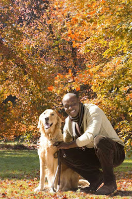 A man and his dog in the park in Autumn