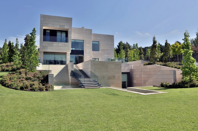 Green grass and modern mansion in Madrid