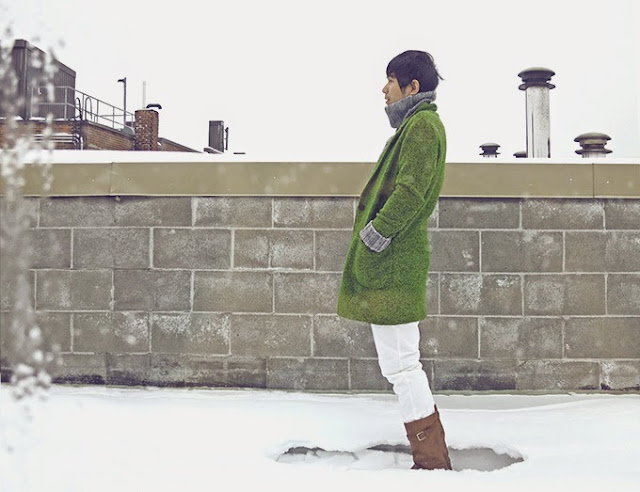 Fashion lookbook, mansstyle with green long wool coat, standing in snow