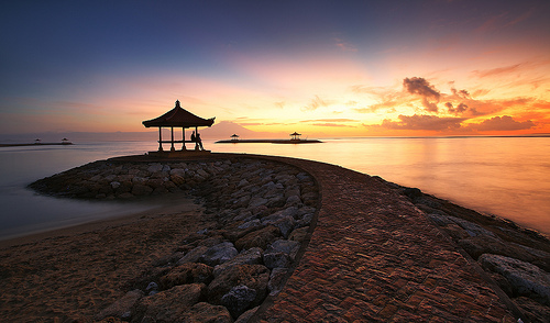 Sanur Beach is ane of the attractions on the coast eastward of the isle of Bali Beaches in Bali; Enjoying Sunset Beach Sanur Bali