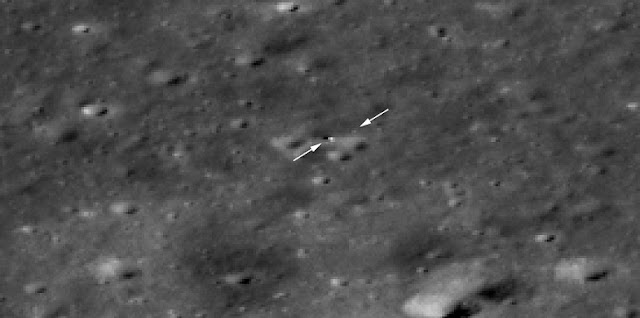 The Chang'e 4 rover is now visible to LROC! Just beyond the tip of the right arrow is the rover and the lander is to the right of the tip of the left arrow. The image appears blocky because it is enlarged 4x to make it easier to see the two vehicles. North is to the upper right, LROC NAC M1303570617LR. Credits: NASA/Goddard/Arizona State University