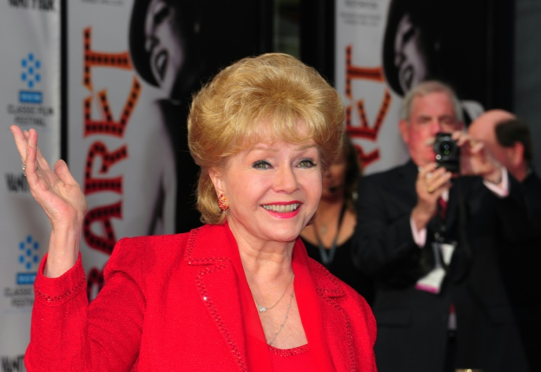 Film legend Debbie Reynolds has died after collapsing at the Beverly Hills home of her son and being rushed to hospital. AFP/File / FREDERIC J. BROWN