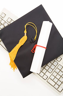 Illustration featuring graduation cap and tassle, diploma and keyboard