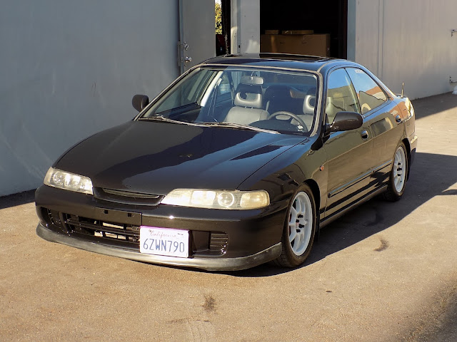 Integra with faded paint after complete car paint job at Almost Everything Auto Body.