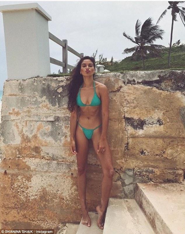 Shanina Shaik flaunts her supermodel figure in mint bikini during tropical getaway