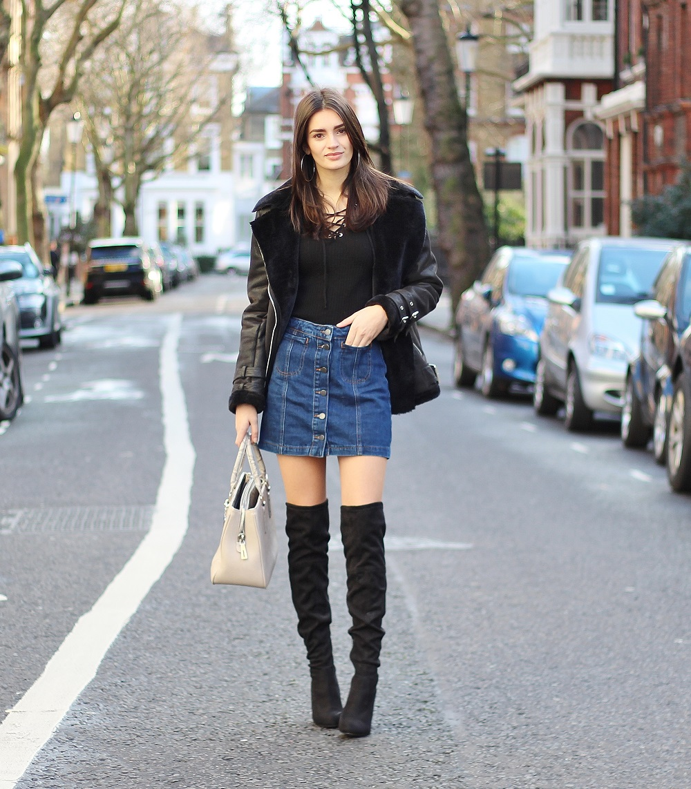 peexo fashion blogger wearing denim skirt and over the knee boots