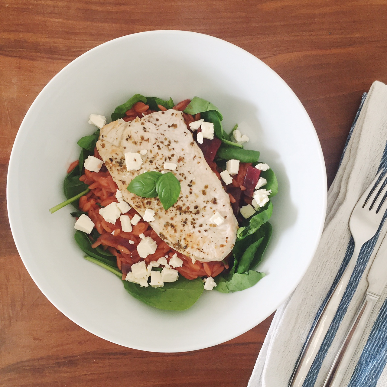 Beetroot orzotto recipe with feta, grilled turkey, on a bed of spinach
