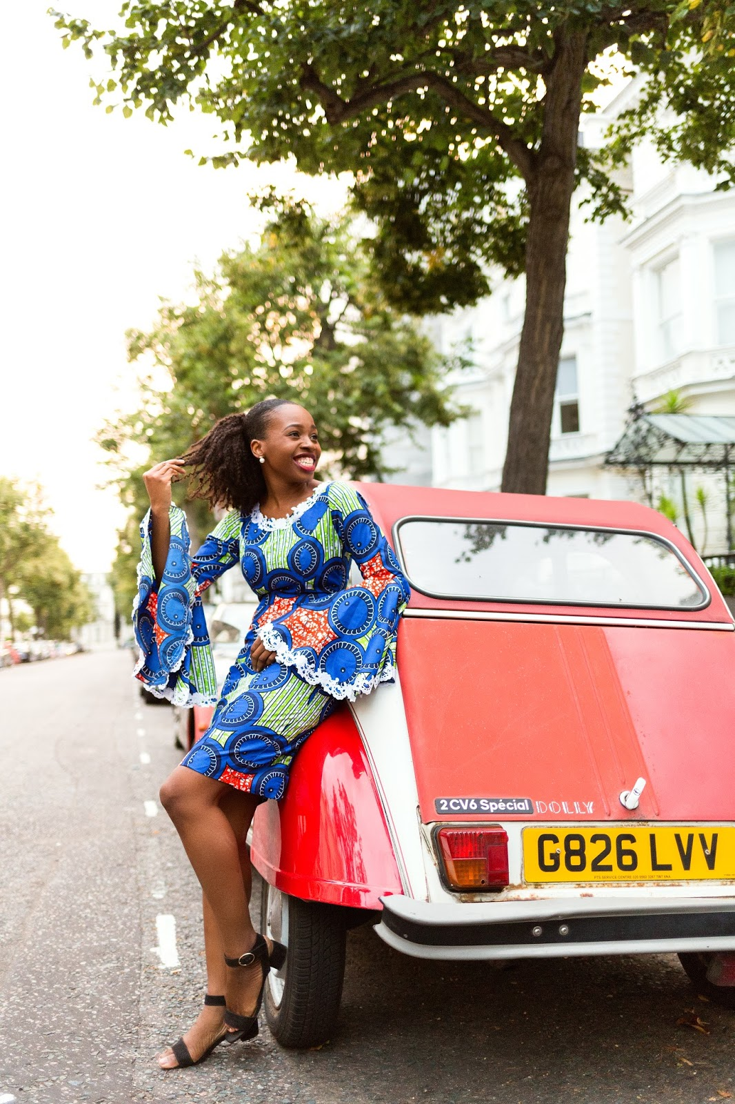 Nigerian Fashion Blogger with Retro Red Car