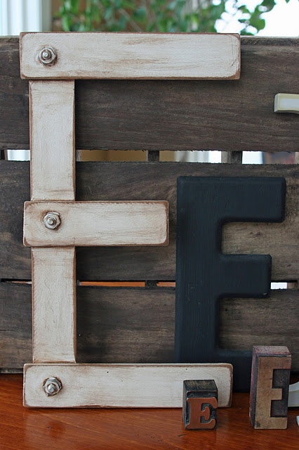These decorative letters made from paint sticks are industrial and great decor pieces.