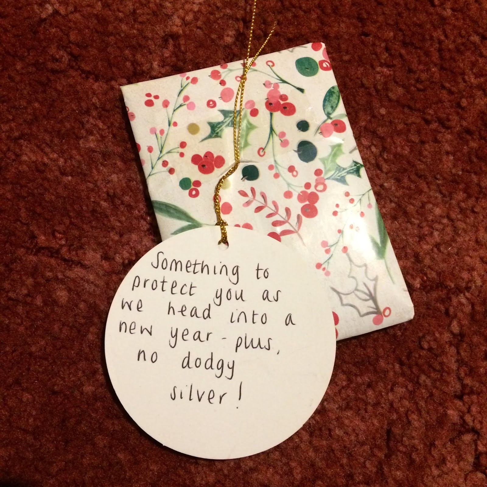 Wrapped present with a tag reading,