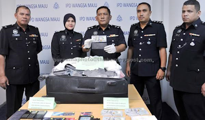 Nigerian man who posed as a UN officer arrested in Malaysia for 'black money' scam