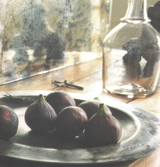 Still life photograph:  platter of figs, on charger, glass bottle, image via The French Home by Josephine Ryan, edited by lb for linenandlavender.net - http://www.linenandlavender.net/2009/07/linen-and-lavender.html