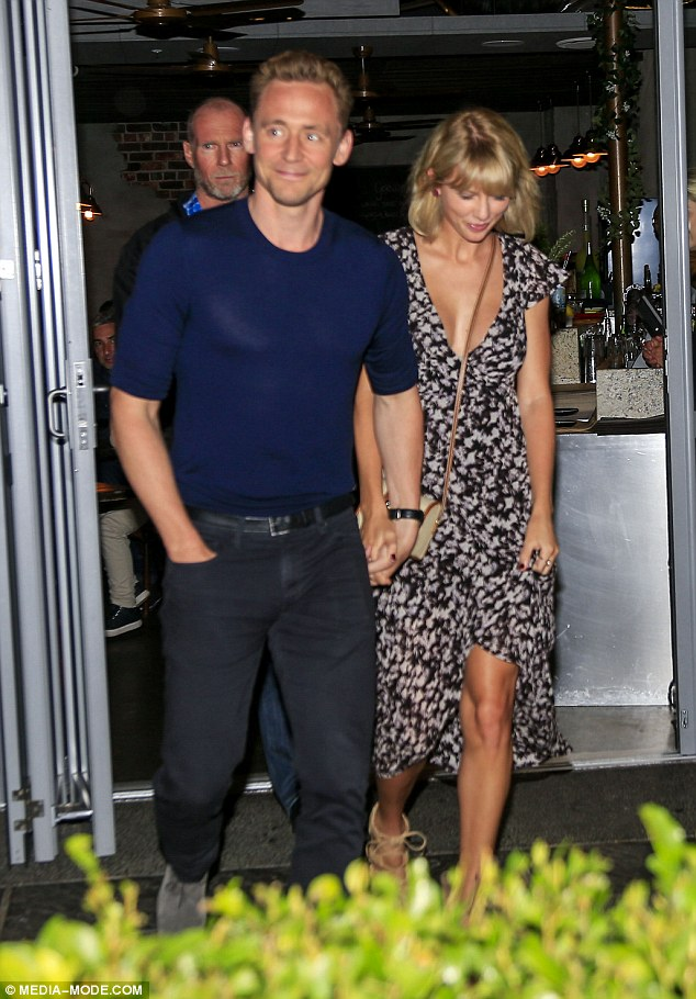 Taylor Swift flaunts low cut dress for date with Tom Hiddleston in Gold Coast