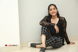 Actress Punarnavi Bhupalam Stills in Black Dress at Pittagoda Press Meet  0183.JPG