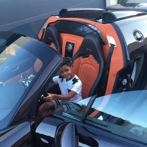 Cristiano Ronaldo shares pics of his son test-riding his new Bugatti (photos)