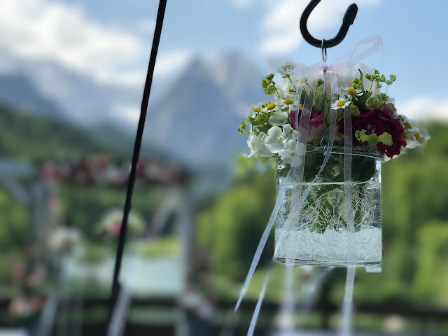 hanging glasses along the aisle,  shades of raspberry and apricot, lake-side wedding in the Bavarian mountains, Garmisch-Partenkirchen, Germany, wedding venue Riessersee Hotel, wedding planner Uschi Glas, getting married abroad