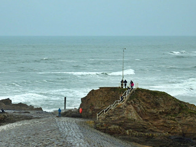 Viewing Chapel Rock and breakwater from cliffs at Bude, Cornwall