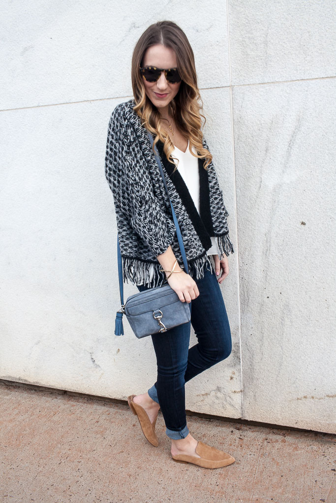 A fringe cardigan and dark wash denim for a casual work day.