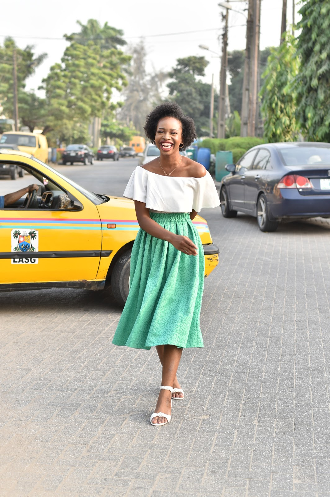 Green Midi Skirt & White Off Shoulder Top on African Fashion Blogger