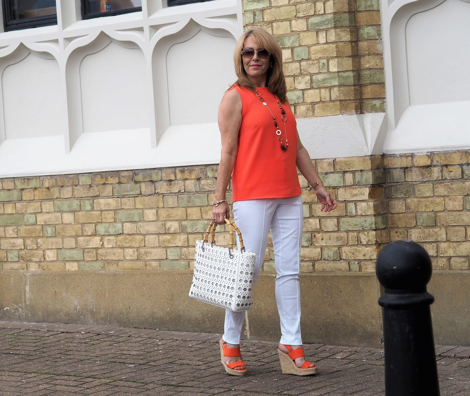 Blogger Laurie Bronze from Vanity and Me in orange and white for the 5 Over 50 Challenge