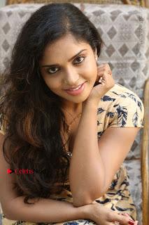 Telugu Actress Karunya Chowdary Stills in Short Dress at ATM Not Working Press Meet  0244.jpg