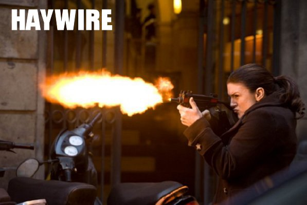 Haywire Movie - Mallory (Gina Carano) fires a machine gun