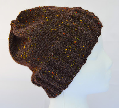 brown adult sized beanie, slightly slouchy hat with cables on the brim