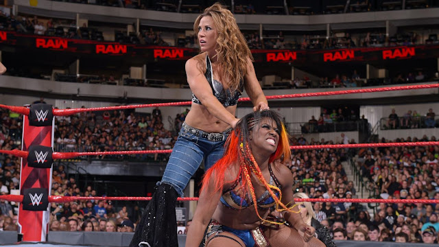 Nia Jax & Ember Moon def. Mickie James & Alicia Fox
