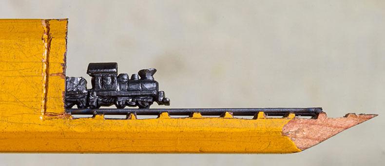 El mas minúsculo tren que alguna vez ha sido tallado en la mina de un lápiz