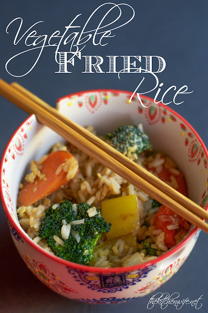 A decorative bowl of the Vegetable Fried Rice, with chop sticks sitting on top of it, and the title at the top.