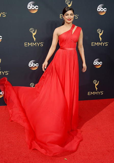 Priyanka Chopra in Bright Red Half Shoulder Long Gown On the Red Carpet of Emmy Awards 2016