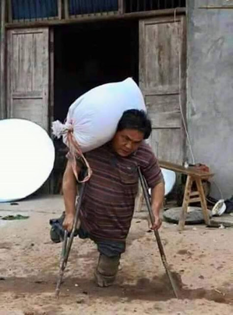 INSPIRING: Man With No Legs Carries Heavy Sacks To Support His Children!