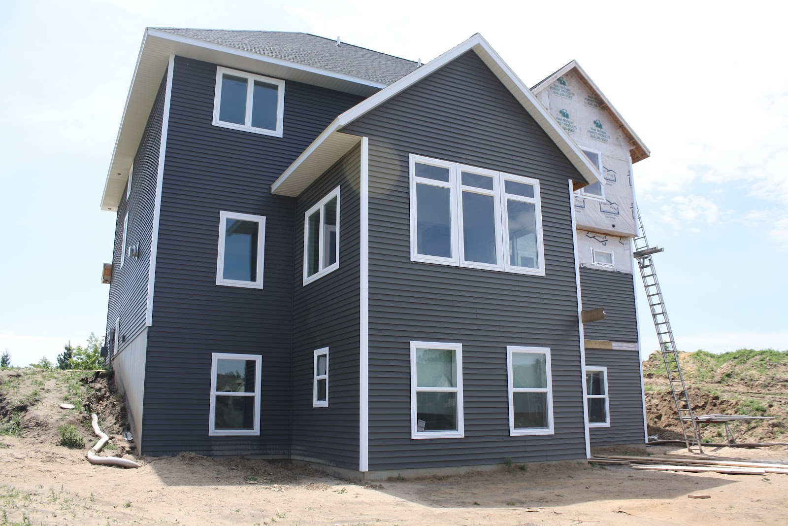 Inspiring And Simple Dark Grey Siding With White Trim