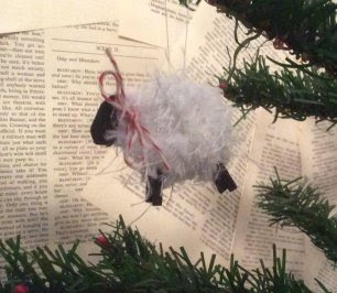 Painted sheep ornament made with yarn