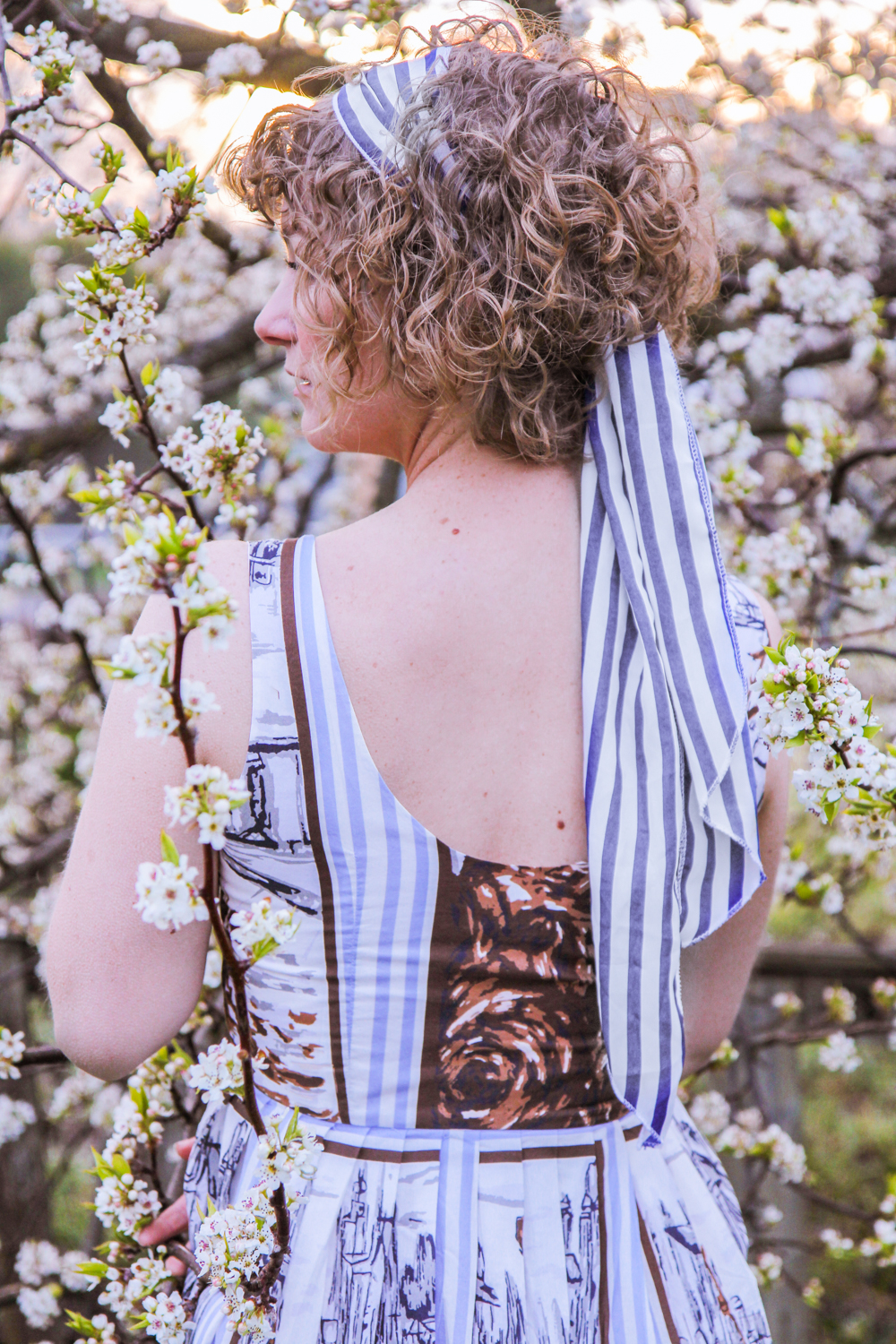 Liana of @findingfemme in Lazybones Venesia print organic cotton dress.