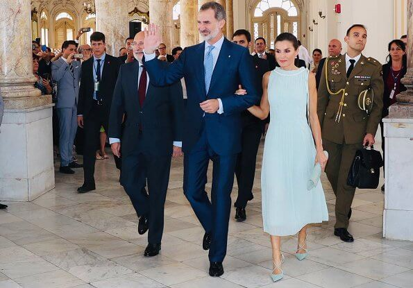 Queen Letizia wore Adolfo Dominguez embroidered cotton dress with belt. Letizia wore a new aquamarine blue midi dress