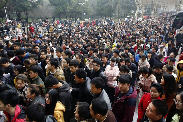 Hundreds of thousands tussle for government jobs in China's toughest exam